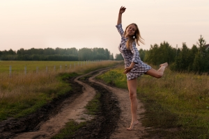 young-girl-dancing-happy-in-a-field-1386581-m